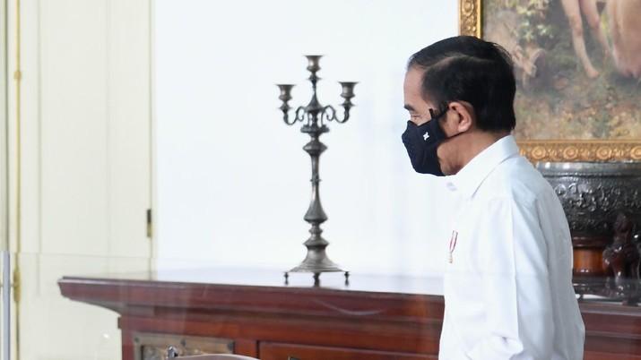 Presiden Joko Widodo Menerima Tim Vaksin Merah Putih di Istana Bogor (BPMI/ Lukas)