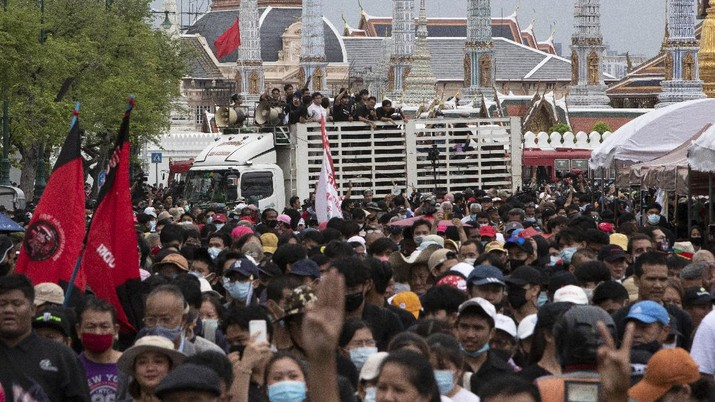 One of the pro-democracy student leaders, Parit Chiwarak, white shirt in the background on the truck, participates in a protest in Bangkok, Thailand, Sunday, Sept. 20, 2020. The mass student-led rally that began Saturday is the largest in a series of protests this year, with thousands camping overnight near a royal palace, demanding for new elections and reform of the monarchy. (AP Photo/Sakchai Lalit)