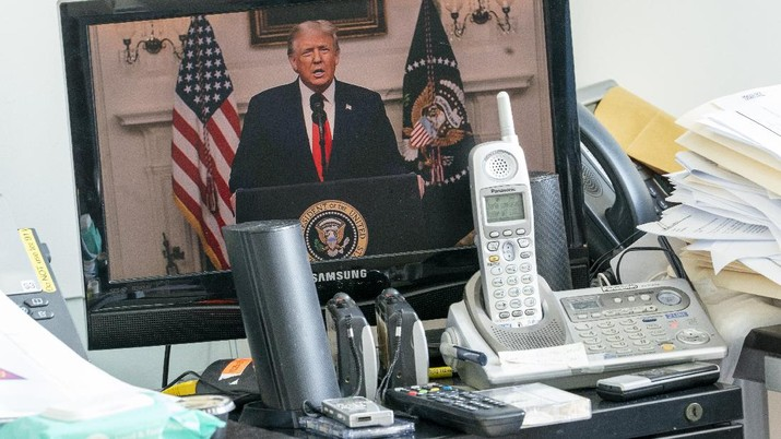 U.S President Donald Trump is seen on a video screen remotely addressing the 75th session of the United Nations General Assembly, Tuesday, Sept. 22, 2020, at U.N. headquarters. This year's annual gathering of world leaders at U.N. headquarters will be almost entirely