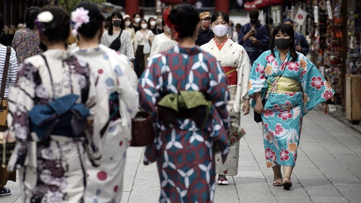 People wearing protective masks to help curb the spread of the coronavirus walk at shopping arcade at Asakusa district Tuesday, Sept. 29, 2020, in Tokyo. The Japanese capital confirmed more than 200 coronavirus cases on Tuesday. (AP Photo/Eugene Hoshiko)