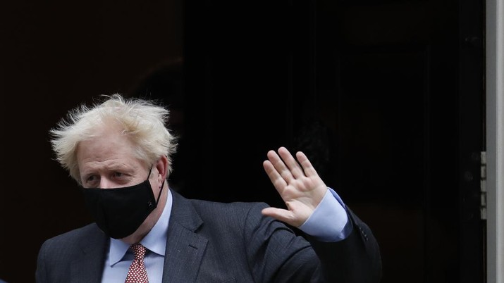 Britain's Prime Minister Boris Johnson waves to the media as he leaves 10 Downing Street or go to the House of Commons his weekly Prime Minister's Questions in London, Wednesday, Sept. 30, 2020. (AP Photo/Alastair Grant)