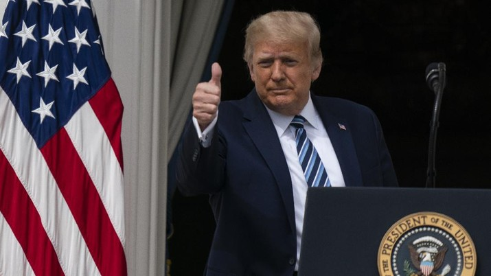 With two bandages on his hand, President Donald Trump gestures while speaking from the Blue Room Balcony of the White House to a crowd of supporters, Saturday, Oct. 10, 2020, in Washington. (AP Photo/Alex Brandon)