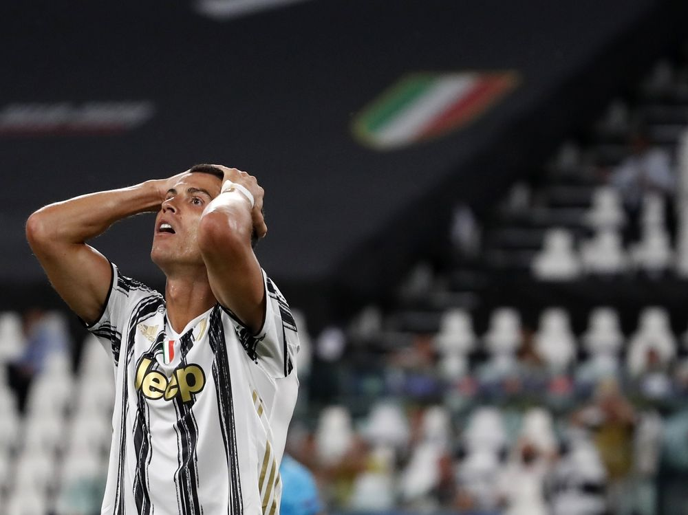 FILE - In this Friday, Aug. 7, 2020 file photo Juventus' Cristiano Ronaldo reacts during the Champions League round of 16 second leg, soccer match between Juventus and Lyon at the Allianz stadium in Turin, Italy. The Portuguese soccer federation says Cristiano Ronaldo has tested positive for the coronavirus. The federation says Ronaldo is doing well and has no symptoms. He has been dropped from the country's Nations League match against Sweden on Wednesday. (AP Photo/Antonio Calanni, File)