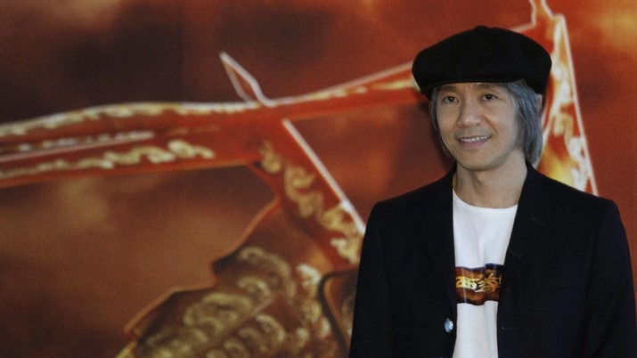 Hong Kong director Stephen Chow smiles during a press conference of his new film