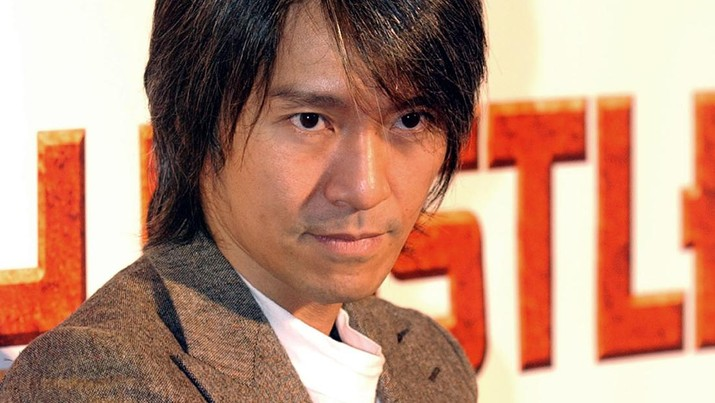 ** FILE ** Hong Kong comedian Stephen Chow poses for media while promoting his new movie