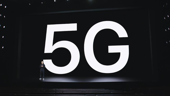 """This image provided by Apple shows Apple CEO Tim Cook making a presentation on 5G and the new iPhone 12, which was unveiled Tuesday, Oct. 13, 2020. A much-hyped network upgrade called """"5G"""" means different things to different people. To industry proponents, it's the next huge innovation in wireless internet. To the U.S. government, it's the backbone technology of a future that America will wrestle with China to control. To many average people, it's simply a mystery. (Apple via AP)"""