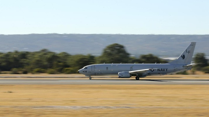 A U.S. Navy P-8 Poseidon takes off from Perth Airport, Australia, en route to rejoin ongoing search operations for the missing Malaysia Airlines Flight 370, Saturday, April 12, 2014. With no new underwater signals detected, Australian Prime Minister Tony Abbott said Saturday that the massive search for the Malaysian jet would likely continue