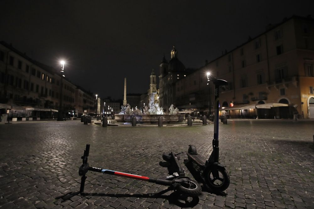 A view of an empty Piazza Navona Square after the start of a curfew, Saturday, Oct. 24, 2020. Italian Premier Giuseppe Conte, who imposed severe-stay-at-home limits on citizens early on, then gradually eased travel and other restrictions, has been leaving it up to regional governors in this current surge of infections to order restrictions such as overnight curfews, including in places like Rome, Milan and Naples. (AP Photo/Alessandra Tarantino)