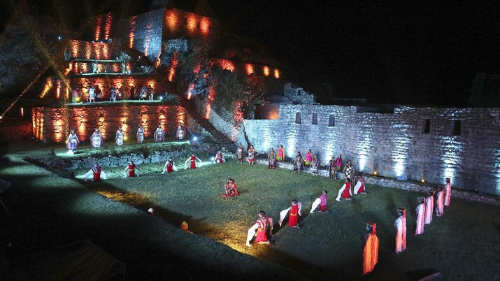 Tourists visit the world-renowned Incan citadel of Machu Picchu as it reopens for the first time since its 8-months-long closure to help curb the spread of COVID-19, in the department of Cusco, Peru, Sunday, Nov. 1, 2020. (AP Photo/Martin Mejia)