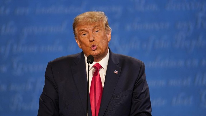 Republican candidate President Donald Trump participates during the second and final presidential debate with Democratic presidential candidate former Vice President Joe Biden Thursday, Oct. 22, 2020, at Belmont University in Nashville, Tenn., with (AP Photo/Julio Cortez)