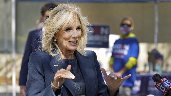 Jill Biden speaks to reporters while campaigning for her husband Democratic presidential candidate and former Vice President Joe Biden, during a voting poll meet and greet Tuesday, Nov. 3, 2020, in St. Petersburg, Fla. (AP Photo/Chris O'Meara)