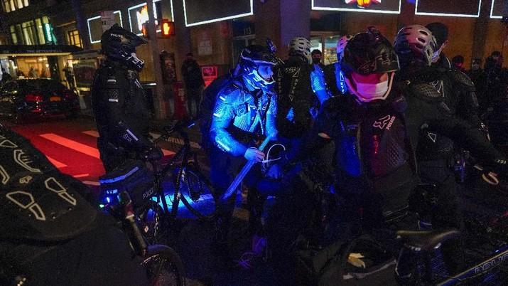 New York Police bike patrol officers make an arrest during a demonstration, Thursday, Nov. 5, 2020, in New York. (AP Photo/Seth Wenig)