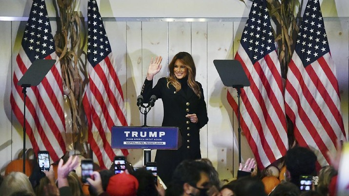 First lady Melania Trump waves to supporters as she exits the stage at Whitewoods in Hollenback Twp., Pa. Saturday, Oct. 31, 2020. (Sean McKeag/The Citizens' Voice via AP)