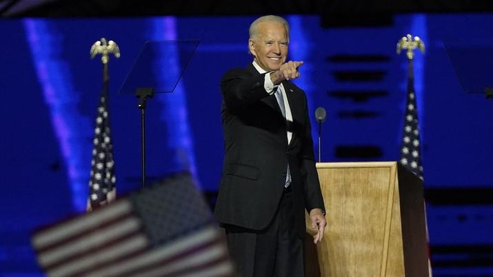 President-elect Joe Biden gestures on stage after speaking, Saturday, Nov. 7, 2020, in Wilmington, Del. (AP Photo/Andrew Harnik, Pool)