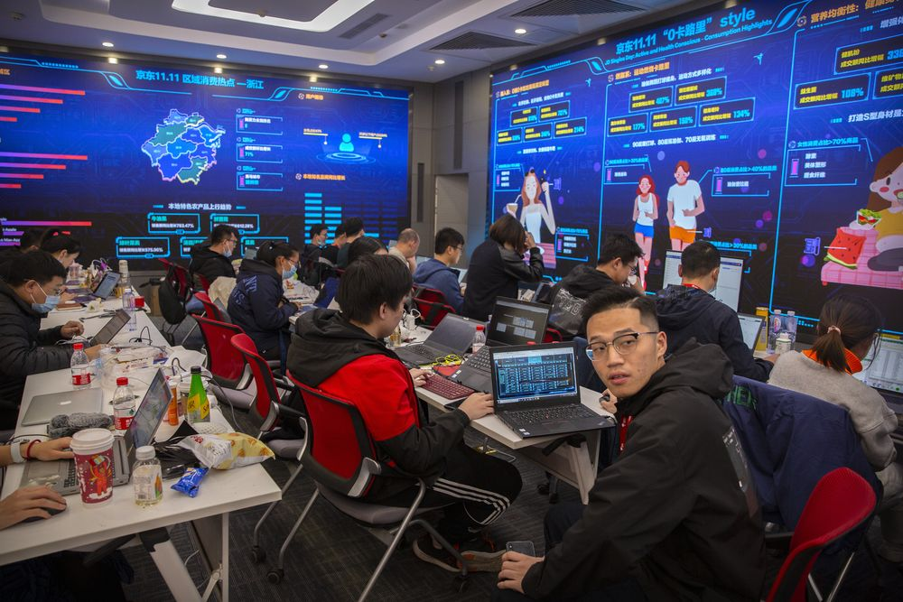 Workers monitor computers in a command center at the headquarters of online retailer JD.com in Beijing, Wednesday, Nov. 11, 2020. Chinese consumers are expected to spend tens of billions on everything from fresh food to luxury goods during this year's Singles' Day online shopping festival, as the country recovers from the pandemic. The shopping festival, which is the world's largest and typically begins in November, is an annual extravaganza where China's e-commerce companies offer generous discounts on their platforms. (AP Photo/Mark Schiefelbein)