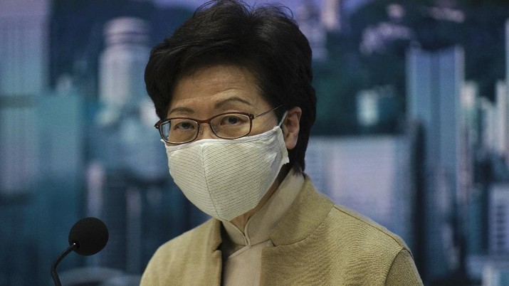 Hong Kong Chief Executive Carrie Lam listens to questions during a news conference in Hong Kong, Wednesday, Nov. 11, 2020. Lam on Wednesday said in a news conference that legislators are expected to act in a proper way and pledge allegiance to the Hong Kong SAR, and that the political party must be composed of patriots. (AP Photo/Vincent Yu)