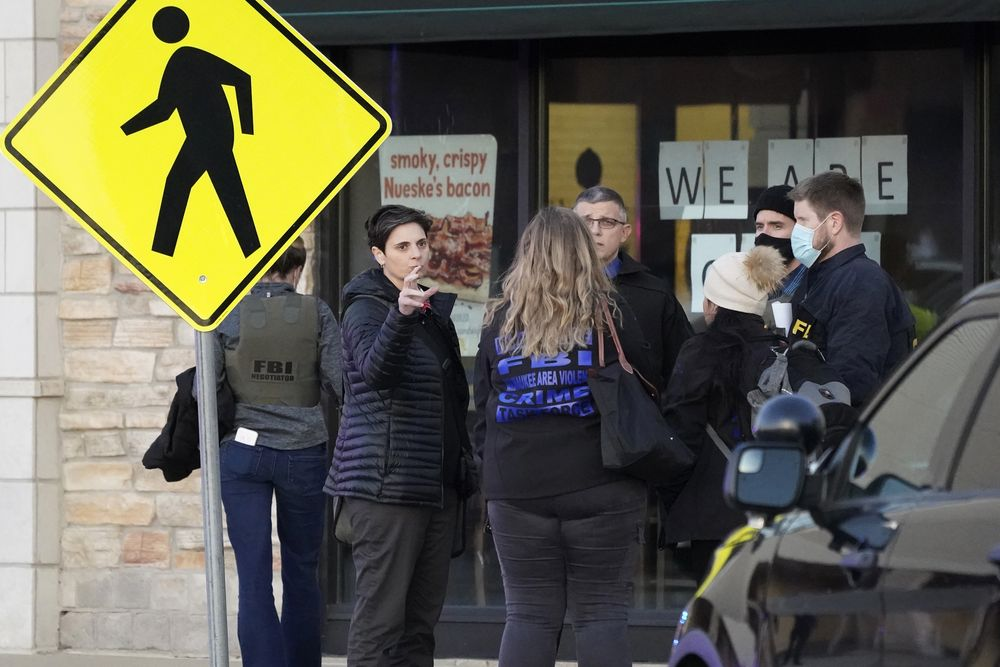 Police officials walk to the Mayfair Mall, Friday, Nov. 20, 2020, in Wauwatosa, Wis. Multiple people were shot Friday afternoon at the mall and police are still searching for the shooter. (AP Photo/Nam Y. Huh)