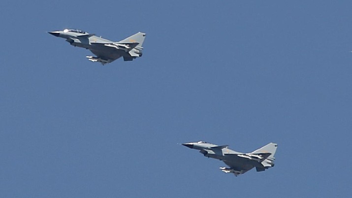 In this Sept. 3, 2015, file photo, two Chinese J-10 fighter jets fly in formation during a parade commemorating the 70th anniversary of Japan's surrender during World War II in Beijing. China on Tuesday, July 25, 2017, denied that two of its J-10 fighter jet pilots operated dangerously during an encounter with a U.S. surveillance plane in international airspace in which the American pilot took evasive action to avoid a possible collision. (AP Photo/Mark Schiefelbein, File)