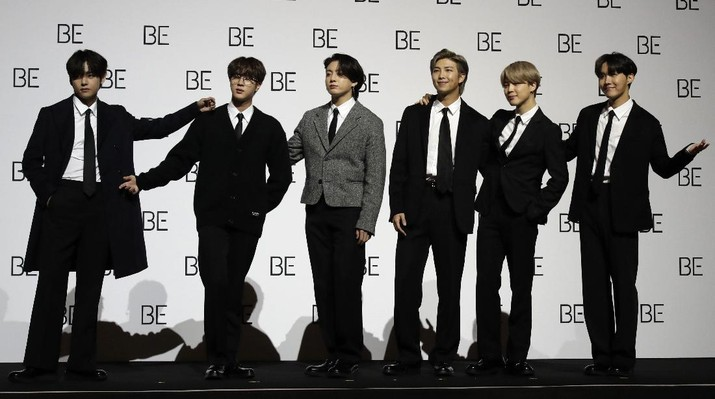Members of South Korean K-pop band BTS pose for photographers during a press conference to introduce their new album