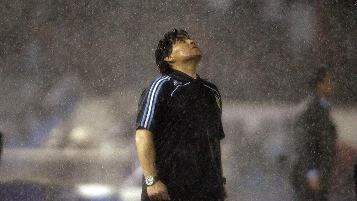 FILE - In this Oct. 10, 2009 file photo, under the pouring rain, Argentina's coach Diego Maradona looks up under the pouring rain during a 2010 World Cup qualifying soccer match against Peru, in Buenos Aires. Argentina won 2-1. The Argentine soccer great who was among the best players ever and who led his country to the 1986 World Cup title before later struggling with cocaine use and obesity, died from a heart attack on Wednesday, Nov. 25, 2020, at his home in Buenos Aires. He was 60. (AP Photo/Natacha Pisarenko, File)
