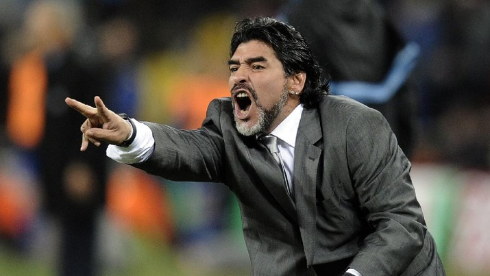 FILE - In this June 27, 2010 file photo, Argentina head coach Diego Maradona gestures during the World Cup round of 16 soccer match between Argentina and Mexico at Soccer City in Johannesburg, South Africa. The Argentine soccer great who was among the best players ever and who led his country to the 1986 World Cup title before later struggling with cocaine use and obesity, died from a heart attack on Wednesday, Nov. 25, 2020, at his home in Buenos Aires. He was 60. (AP Photo/Martin Meissner, File)