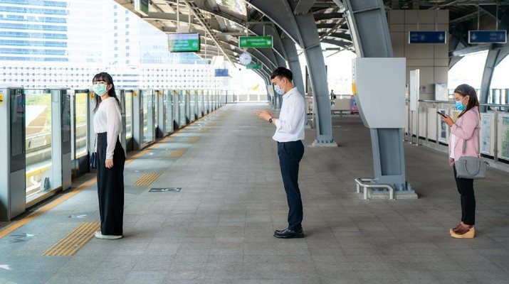 Three Asian people wearing mask standing distance of 1 meter from other people keep distance protect from COVID-19 viruses and people social distancing  for infection risk and disease prevention measures.