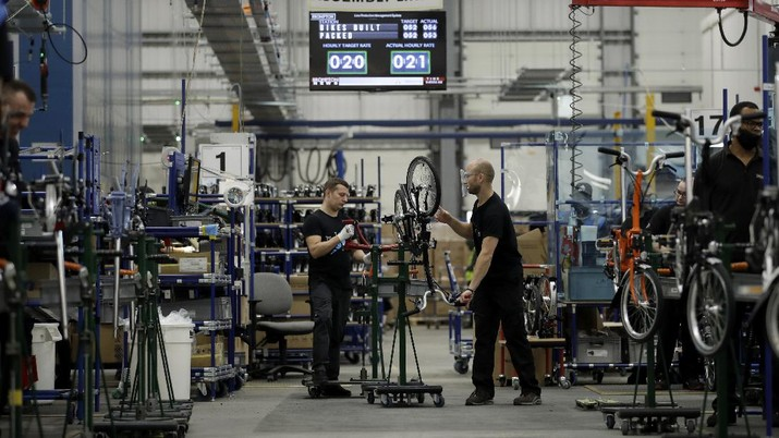 Brompton folding bicycles are assembled at the Brompton factory in west London, Tuesday, Nov. 24, 2020. The team at Brompton Bicycles company thought they were prepared for Britain's Brexit split with Europe, but they face uncertainty about supplies and unexpected new competition from China, all amid a global COVID pandemic.(AP Photo/Matt Dunham)