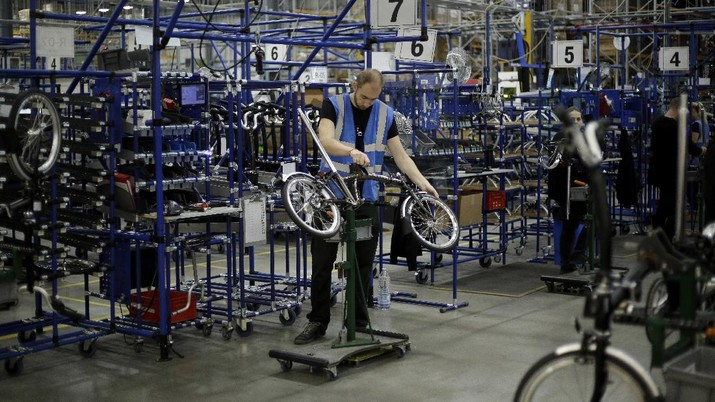Brompton folding bicycles are assembled by hand at the Brompton factory in west London, Tuesday, Nov. 24, 2020.  The team at Brompton Bicycles company thought they were prepared for Britain's Brexit split with Europe, but they face uncertainty about supplies and unexpected new competition from China, all amid a global COVID pandemic.(AP Photo/Matt Dunham)