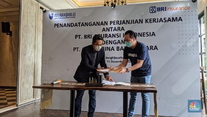 PT BRI Asuransi Indonesia perluas pasar digital dengan menggandeng PT Artha Bina Bhayangkara broker asuransi online melalui asuransiku.id. (CNBC Indonesia/Emir Yanwardhana)