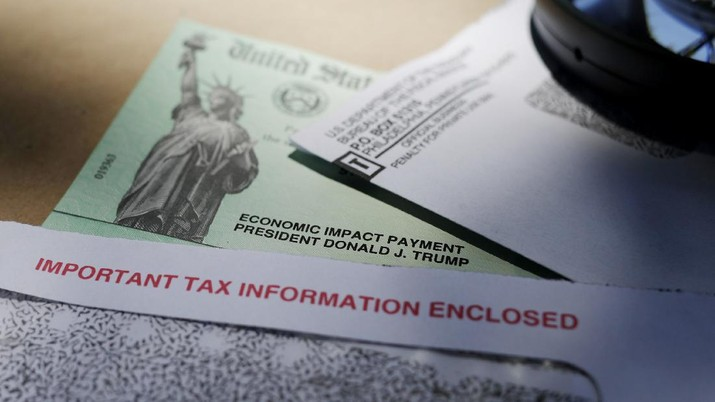 In this April 23, 2020, photo, President Donald Trump's name is seen on a stimulus check issued by the IRS to help combat the adverse economic effects of the COVID-19 outbreak, in San Antonio. The US government has distributed about 130 million economic impact payments to taxpayers in less than 30 days. The IRS anticipates sending more than 150 million payments as part of a massive coronavirus rescue package. The distribution has had some hiccups, including an overwhelmed website, payments to deceased taxpayers and money sent to inactive accounts. (AP Photo/Eric Gay)
