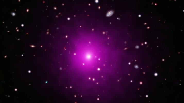 This image of Abell 2261 contains X-ray data from Chandra (pink) showing hot gas pervading the cluster as well as optical data from Hubble and the Subaru Telescope that show galaxies in the cluster and in the background. Astronomers used these telescopes to search galaxy in the center of the image for evidence of a black hole, weighing between 3 and 100 billion times the Sun, that is expected to be there. No sign of this black hole was found, deepening a mystery about what is happening in this system. (X-ray: NASA/CXC/Univ of Michigan/Chandra X-ray Observatory Center)