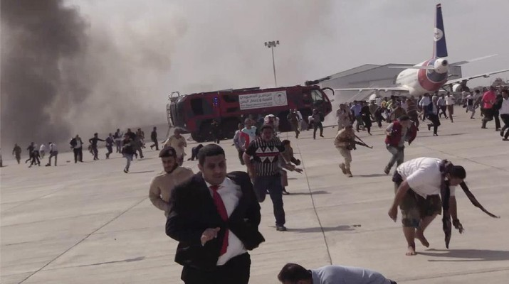 People run following an explosion at the airport in Aden, Yemen, shortly after a plane carrying the newly formed Cabinet landed on Wednesday, Dec. 30, 2020. No one on board the government plane was hurt but initial reports said several people at the airport were killed. (AP Photo)