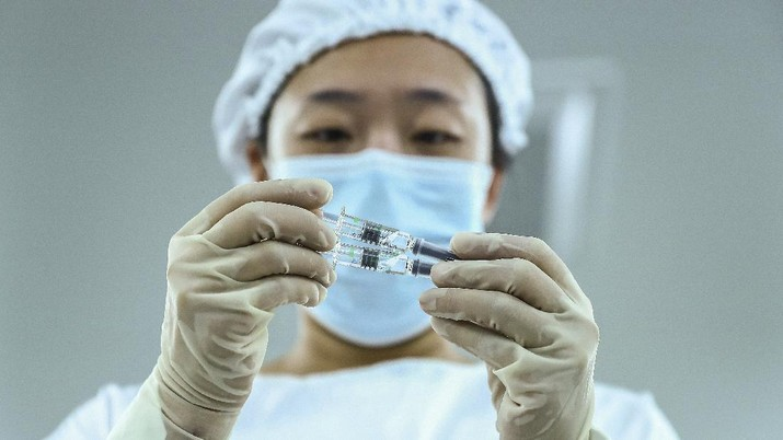 FILE - In this Dec. 25, 2020, file photo, released by Xinhua News Agency, packages of COVID-19 inactivated vaccine products are seen at a production plant of the Beijing Biological Products Institute Co., Ltd, a unit of state-owned Sinopharm in Beijing. China has given conditional approval to a coronavirus vaccine developed by state-owned Sinopharm. The vaccine is the first one approved for general use in China.(Zhang Yuwei/Xinhua via AP, File)
