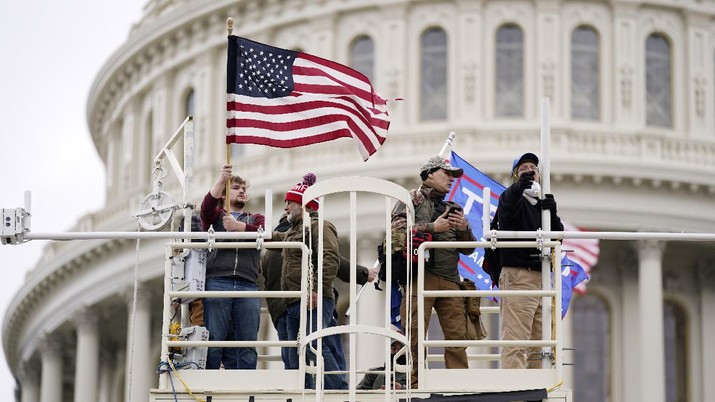 Trump supporters rally Wednesday, Jan. 6, 2021, at the Capitol in Washington. As Congress prepares to affirm President-elect Joe Biden's victory, thousands of people have gathered to show their support for President Donald Trump and his claims of election fraud. (AP Photo/Julio Cortez)