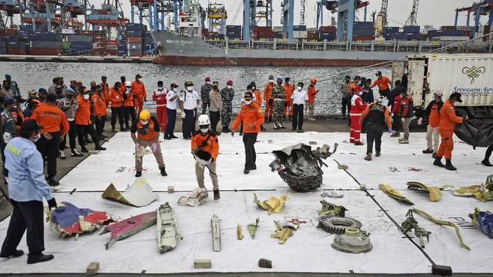 Parts of aircrafts found on the waters off Java Island where a Sriwijaya Air passenger jet crashed are laid out for inspection, at Tanjung Priok Port in Jakarta, Indonesia, Monday, Jan. 11, 2021. The search for the black boxes of a crashed Sriwijaya Air jet intensified Monday to boost the investigation into what caused the plane carrying dozens of people to nosedive at high velocity into the Java Sea. (AP Photo/Dita Alangkara)