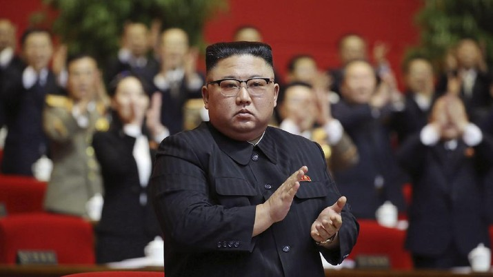 """In this photo provided by the North Korean government, North Korean leader Kim Jong Un claps his hands at the ruling party congress in Pyongyang, North Korean, Sunday, Jan. 10, 2021. Kim was given a new title, """"general secretary"""" of the ruling Workers' Party, formerly held by his late father and grandfather, state media reported Monday, Jan. 11, in what appears to a symbolic move aimed at bolstering his authority amid growing economic challenges. Independent journalists were not given access to cover the event depicted in this image distributed by the North Korean government. The content of this image is as provided and cannot be independently verified. Korean language watermark on image as provided by source reads:"""