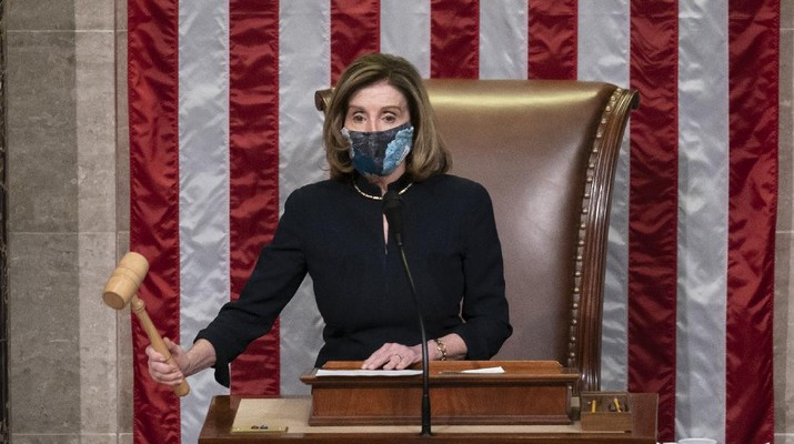 Speaker of the House Nancy Pelosi, D-Calif., leads the final vote of the impeachment of President Donald Trump for his role in inciting an angry mob to storm the Congress last week, at the Capitol in Washington, Wednesday, Jan. 13, 2021. (AP Photo/J. Scott Applewhite)
