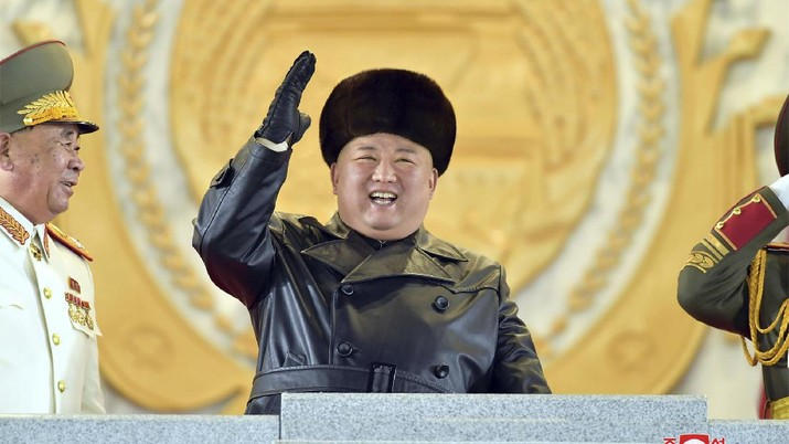 In this photo provided by the North Korean government, North Korean leader Kim Jong Un waves as Kim attended a military parade, marking the ruling party congress, at Kim Il Sung Square in Pyongyang, North Korea Thursday, Jan. 14, 2021. Independent journalists were not given access to cover the event depicted in this image distributed by the North Korean government. The content of this image is as provided and cannot be independently verified. Korean language watermark on image as provided by source reads: