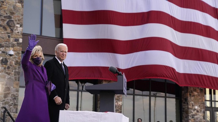 President-elect Joe Biden stands with his wife Jill Biden after speaking at the Major Joseph R.