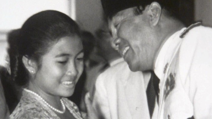 FILE--Megawati Sukarnoputri, left, is embraced by her father and Indonesia's first president Sukarno at the State Palace in Jakarta on Jan. 10, 1960. Megawati, now 54, has assumed her late father's mantle and is set to move back into the palace where she grew up. The legislature removed President Abdurrahman Wahid on Monday, July 23, 2001. Megawati, who had been vice president, was sworn in as president. (AP Photo)