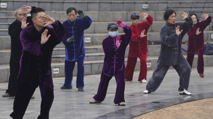 Residents practice Taiji at a park in Wuhan in central China's Hubei Province on Saturday, Jan. 23, 2021. A year after it was locked down to contain the spread of coronavirus, the central Chinese city of Wuhan has largely returned to normal, even as China continues to battle outbreaks elsewhere in the country. (AP Photo/Ng Han Guan)