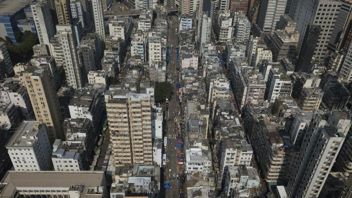 A closed area of Jordan district is seen in Hong Kong, Saturday, Jan. 23, 2021. Thousands of Hong Kong residents were locked down Saturday in an unprecedented move to contain a worsening outbreak in the city, authorities said. (AP Photo/Kin Cheung)