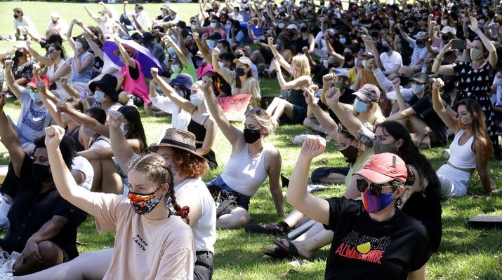 Protes peringatan hari nasional Australia. (AP/Rick Rycroft)