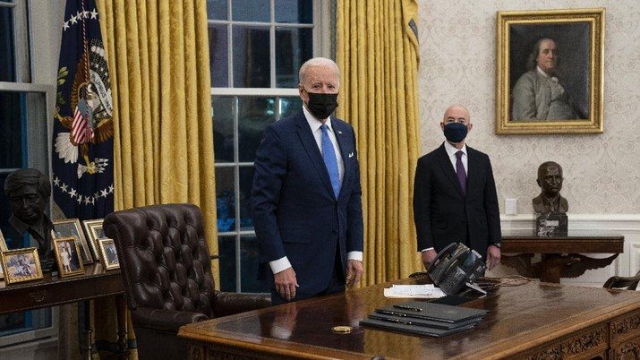 President Joe Biden delivers remarks on immigration, in the Oval Office of the White House, Tuesday, Feb. 2, 2021, in Washington. (AP Photo/Evan Vucci)