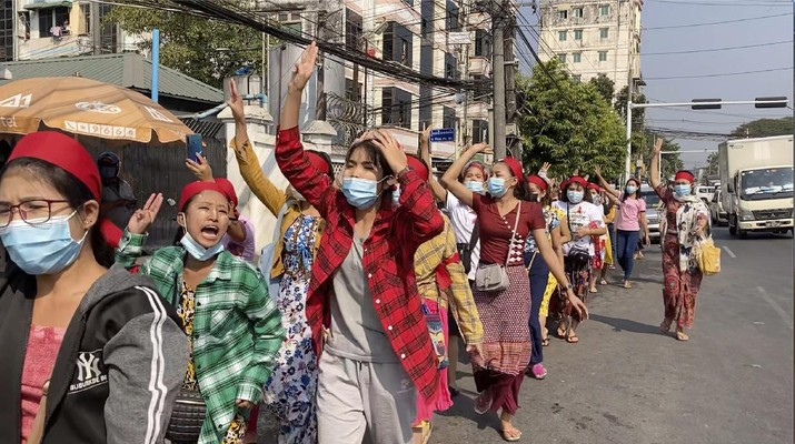 In this image made from video, protesters flash the three-fingered salute while they march Saturday, Feb. 6, 2021, in Yangon, Myanmar. The military authorities in charge of Myanmar broadened a ban on social media following this week's coup, shutting access to Twitter and Instagram, while street protests continued to expand Saturday as people gathered again to show their opposition to the army takeover. (AP Photo)