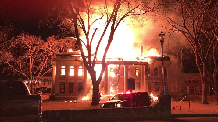 This photo provided by Mason County Judge Jerry Bearden shows a fire at the Mason County Courthouse, Thursday, Feb. 4, 2021, in Mason, Texas. An official says a suspect has been taken into custody following the massive fire that destroyed all but the rock outer walls of the 111-year-old courthouse. Fire investigators suspect arson in both the courthouse fire and a fire around the same time at a house about a mile away. (Mason County Judge Jerry Bearden via AP)
