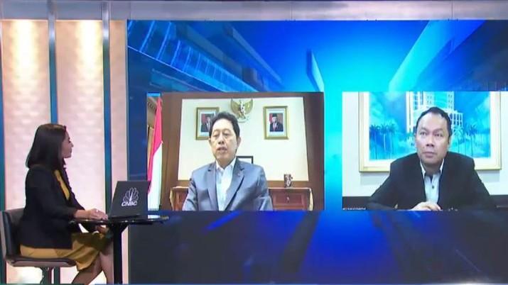 Komisioner Otoritas Jasa Keuangan (OJK), Heru Kristiyana dan Direktur Utama Bank KB Bukopin, Rivan Achmad Purwantono.
