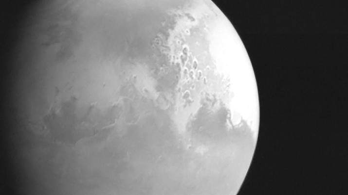 In this undated photo released by the China National Space Administration, a view of the planet Mars is captured by China's Tianwen-1 Mars probe from a distance of 2.2 million kilometers (1.37 million miles). A Chinese spacecraft appears poised to enter orbit around Mars on Wednesday, Feb. 10, 2021, one day after an orbiter from the United Arab Emirates did so, and about a week ahead of an American attempt to put down another spacecraft on the surface of the red planet. (CNSA/Xinhua via AP)