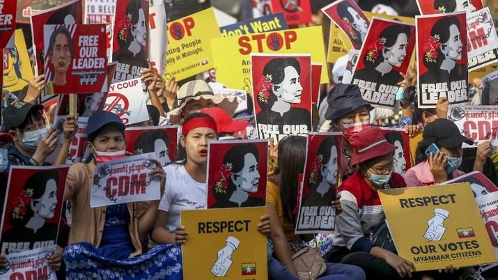 Demonstrators display images of detained Myanmar leader Aung San Suu Kyi during a protest against the military coup in Yangon, Myanmar Tuesday, Feb. 16, 2021. Security forces in Myanmar pointed guns toward anti-coup protesters and attacked them with sticks Monday, seeking to quell the large-scale demonstrations calling for the military junta that seized power this month to reinstate the elected government. (AP Photo)