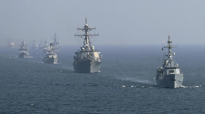 "Warships from various countries take part in multinational military exercise, ""Aman"" or peace exercise in the Arabian Sea near Karachi, Pakistan, Monday, Feb. 15, 2021. Warships over 40 countries including the United States, Russia, Britain and China are participating the five-day multinational exercise hosted by Pakistan Navy in the Arabian Sea as part of Islamabad's years-long effort to bring security to the area, Pakistan navy said. (AP Photo/Mohammad Farooq)"